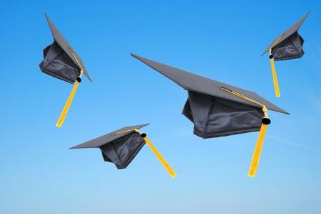 graduation caps thrown in the air Stock Photo - 8426027
