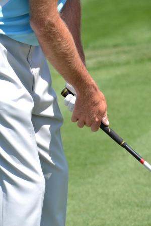 man gripping golf club Stock Photo