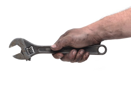 dirty hand holding wrench Stock Photo - 9372576