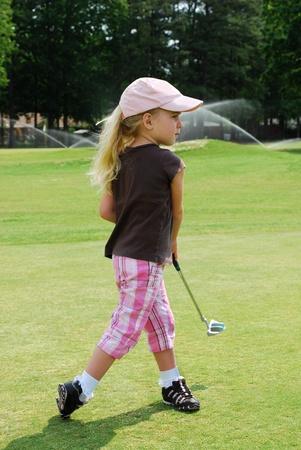 child putting golf ball Stock Photo