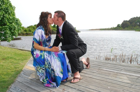 couple kissing by the water photo