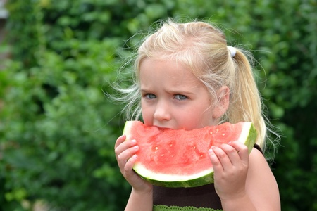little girl eating watermelon Stock Photo - 9680121
