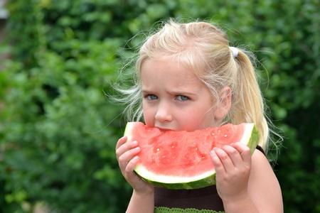 little girl eating watermelon Stock Photo - 9680121