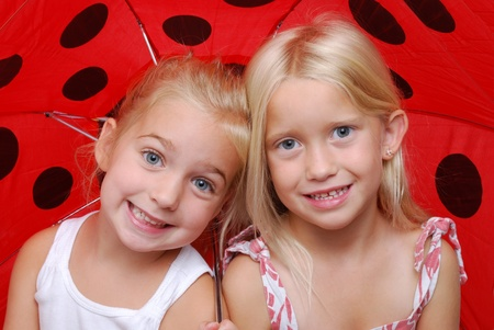 silliness: two girls under a umbrella