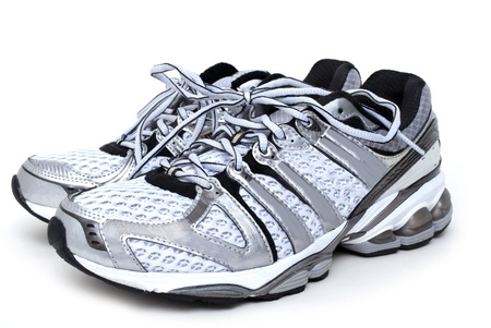 tennis shoe: pair of running shoes white background