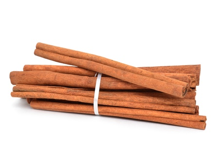 dried herbs: cinnamon sticks white background