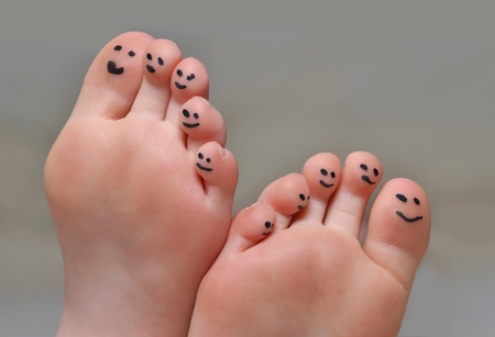 silly face: little toes with smiley faces Stock Photo