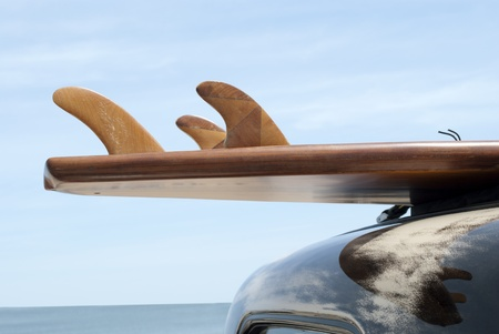 surfboard fin: surfboard on car roof Stock Photo