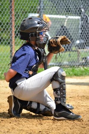 baseball catcher: young baseball player