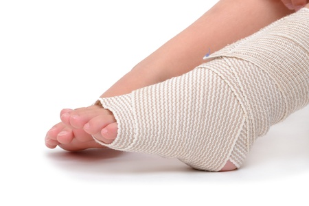 kids feet: child foot wrapped with bandage Stock Photo