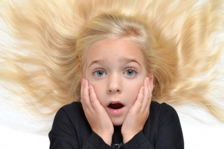 silliness: young girl with expression on face Stock Photo