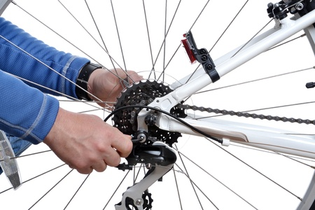 man repairing bicycle wheel photo