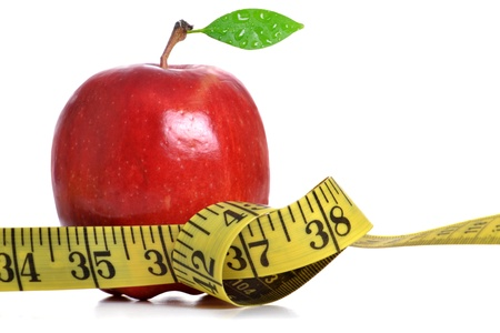tape measure and red apple white background