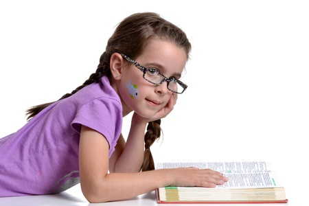 young with glasses reading a book photo
