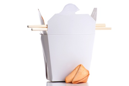 container of chinese food with chop sticks photo