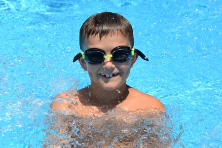 sun  soaked: boy playing in swimming pool Stock Photo