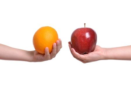 compare apple to orange white background Stock Photo