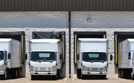 delivery truck: trucks at loading dock shipping industry