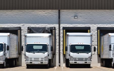 loading dock: trucks at loading dock shipping industry