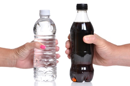 bottled water and bottle of soda white background