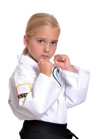 artes marciales: Chica en karate fondo blanco uniforme Foto de archivo