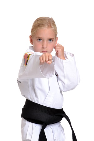 girl in karate uniform white background
