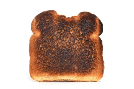 burnt toast: slice of burnt toast white background