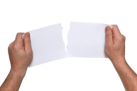 lacrime: uomo strappando un pezzo di carta bianca Archivio Fotografico