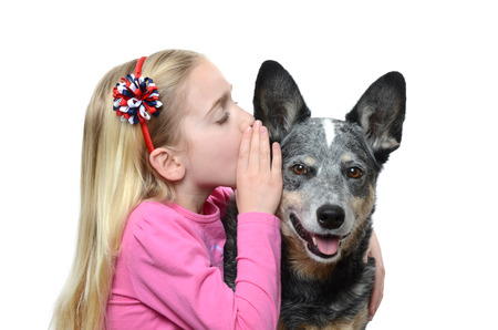 little girl whispering to her dog photo