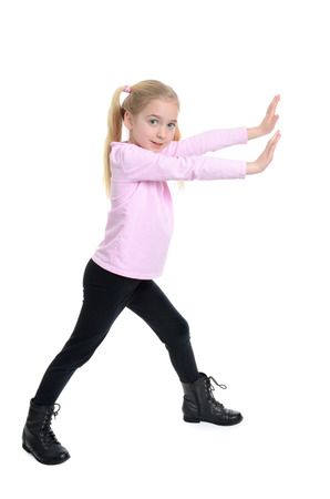 silliness: little girl with arms extended in front pushing motion Stock Photo