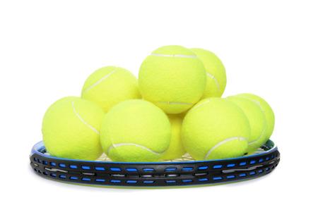 tennis ball: tennis balls piled on racket isolated white background