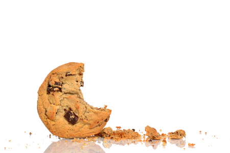 chocolate chip cookie and crumbs isolated white background Foto de archivo