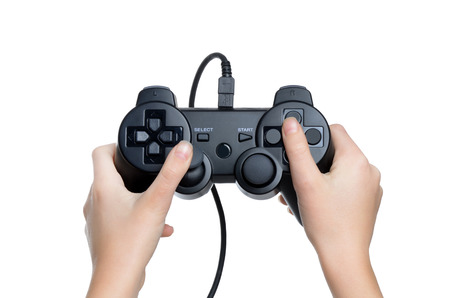 griping: child holding gaming controller isolated white background