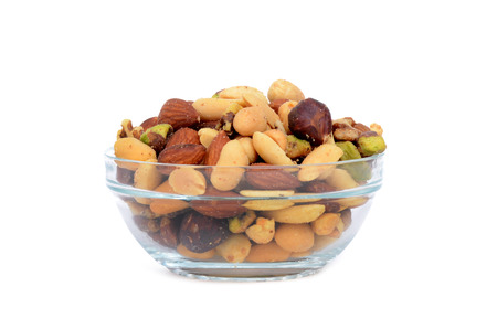 bowl of mixed nuts isolated on white background