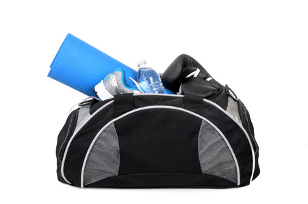 gym bag with shoes yoga mat and water bottle isolated on white background