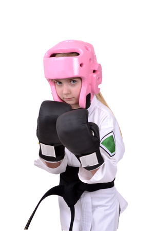 tough girl: little girl wearing karate sparring gear isolated white background