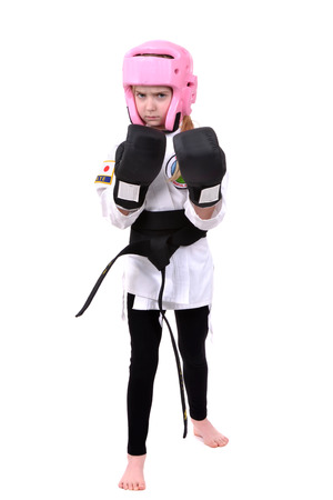 young girl martial arts wearing protective gear isolated on white background photo