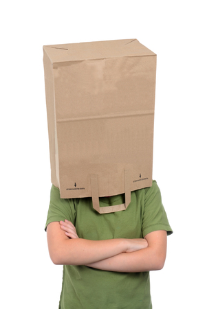 frustration girl: girl with brown paper bag over head isolated on white background Stock Photo