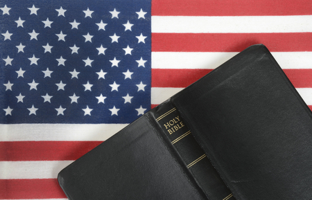 american flag background: bible and American flag background Stock Photo