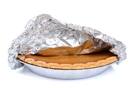 foil: pumpkin pie with foil isolated on white background Stock Photo
