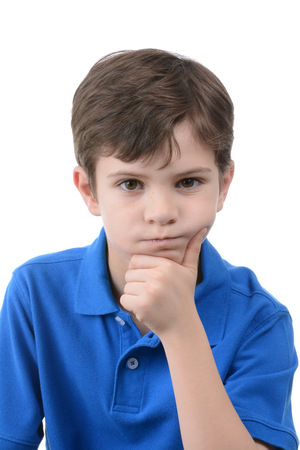 hand on the chin: young boy with hand on chin isolated on white background Stock Photo