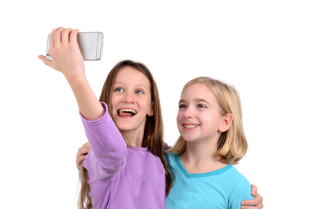 two girls taking a selfie white background photo