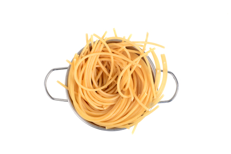 cooked pasta spaghetti noodles in strainer white background