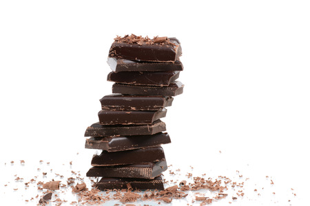 dark chocolate pieces isolated white background