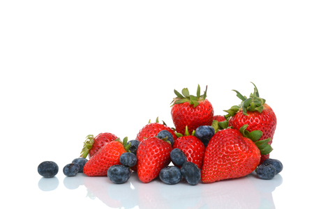 fresh strawberries and blueberries on a white background