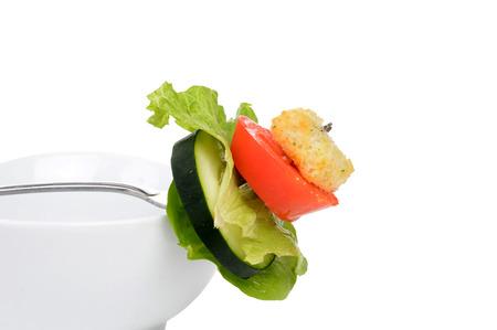 salad on a fork with bowl white background Zdjęcie Seryjne