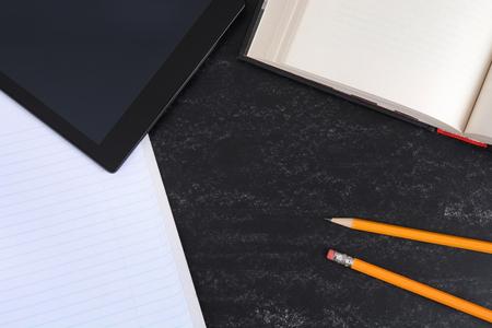 school concept background book,pencils,notebook,tablet on chalkboard