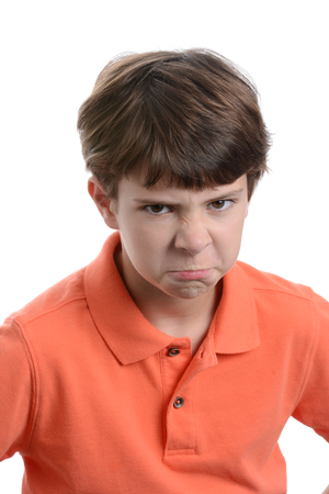 boy with mad facial expression white background