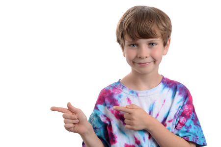 young boy pointing fingers to the side white background Zdjęcie Seryjne