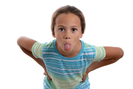 舌の白い背景を突き出して少女 写真素材